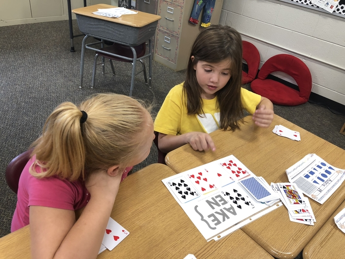 Second and third graders enjoy practicing their math facts with card games!