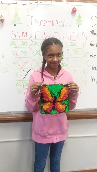 Samara and her latch hook project!