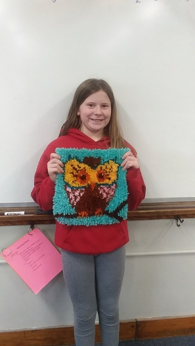 Carleigh and her latch hook project!