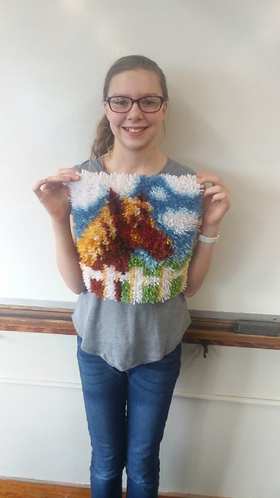 Evelyn and her latch hook project!