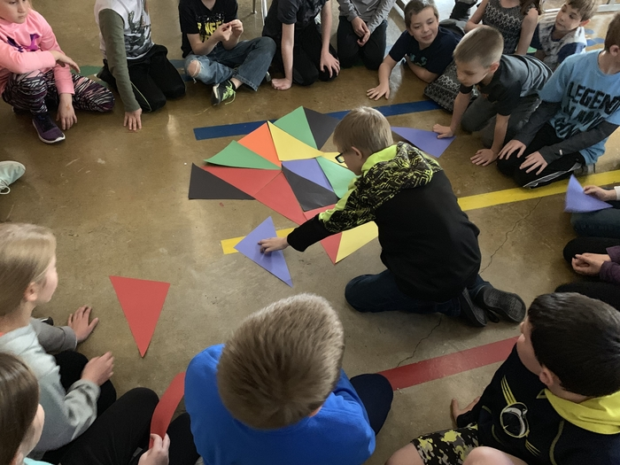 Today in art 3rd and 4th grade synergized to come up with different ways we can organize shapes to create a piece of art in preparation for our collaborative artwork